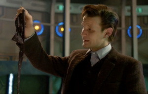 ...he takes off his bow tie, thats one of the most iconic things about The 10th Doctor...his Bow tie.
